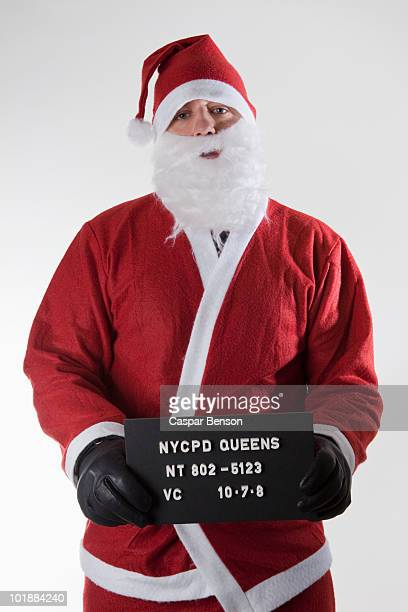 Santa Claus posing for a mug shot