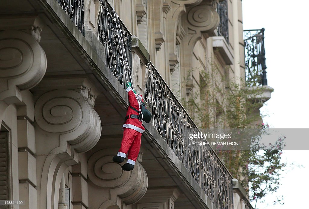 A Santa Claus puppet hangs from a balcony on December 12, 2012 in Paris' 16th district.