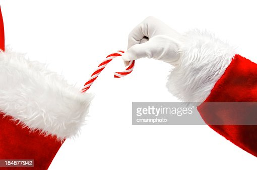 Santa Claus putting a candy cane in a stocking