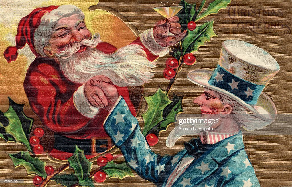 Santa Claus raises a glass of champagne to Uncle Sam while they shake hands over a branch of holly on a Christmas postcard Circa 1909