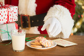 Santa claus reaching for cookie