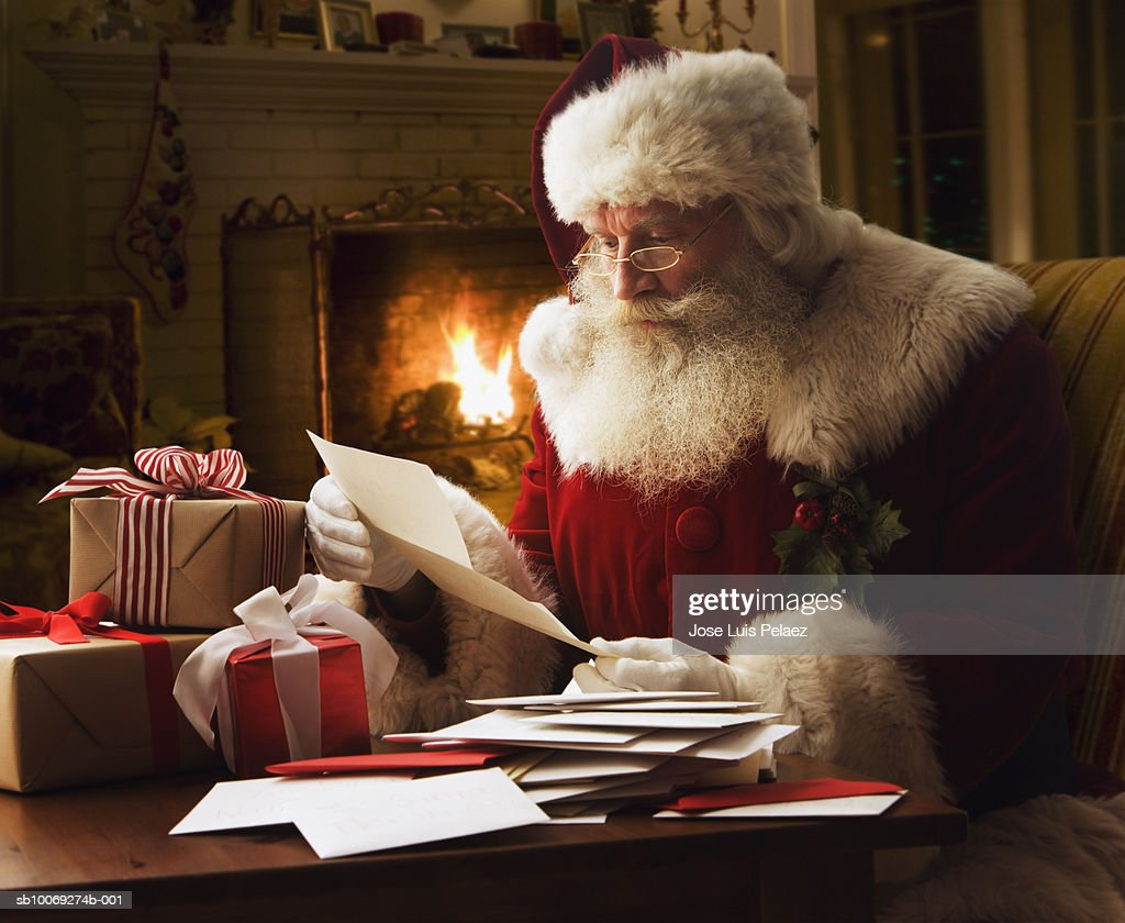 Santa Claus reading letter, close-up : Stock Photo