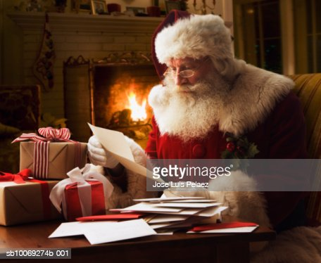 Santa Claus reading letter, close-up : Bildbanksbilder