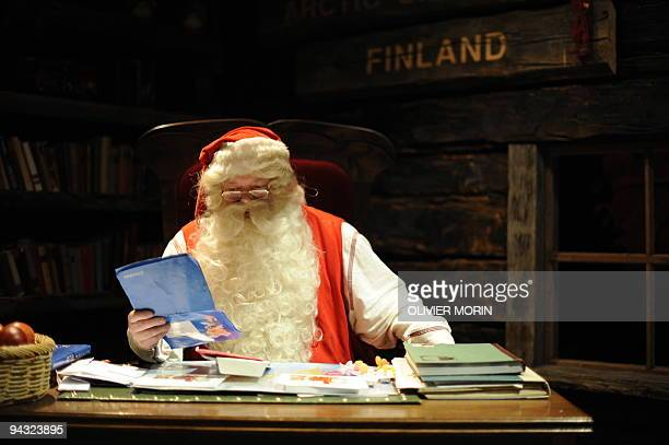 Santa Claus reads letters coming in from the world in his 'office' in Rovaniemi on December 16 2008 Rovaniemi's Christmas theme park is in full swing...