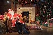 Santa Claus resting in an armchair