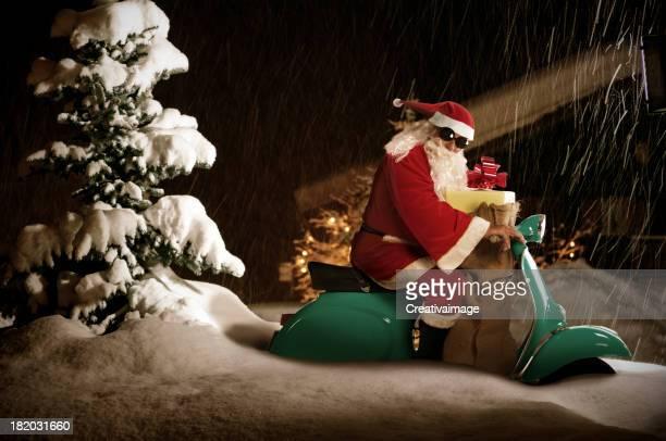 Santa Claus riding on a vespa