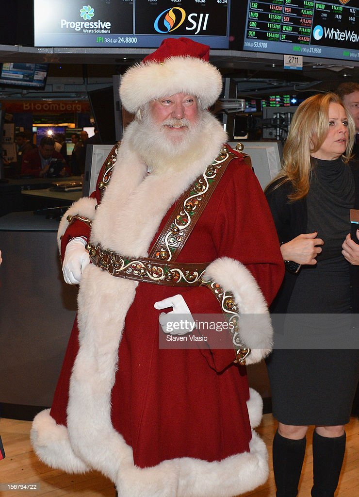 Santa Claus rings The Opening Bell at the New York Stock Exchange to celebrate the 86th Annual Macy's Thanksgiving Day Parade at New York Stock Exchange on November 21, 2012 in New York City.