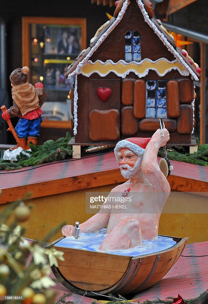 A Santa Claus sculpture taking a bath pictured at the christmas market in Dresden, eastern germany, on December 21, 2012. The' Striezelmarkt' takes place for the 578th time this year.