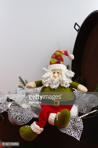 Santa Claus sits on vintage brown coffer : Stock Photo