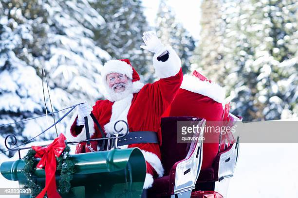 Santa Claus Sitting in His Sleigh Waving