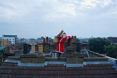 Santa Claus standing on a roof