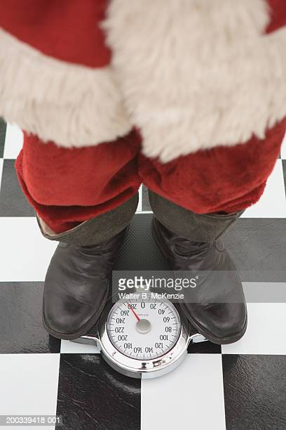 Santa Claus standing on scale