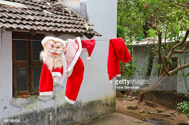 THIRUVANANTHAPURAM VARKALA KERALA INDIA Santa Claus taking a wash and a rest after Christmastime in Varkala