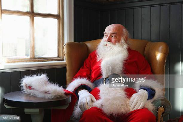 Santa Claus taking break in armchair