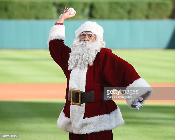 Santa Claus throws out the ceremonial first pitch prior to the 'Christmas in July' promotion game between the Detroit Tigers and the Seattle Mariners...