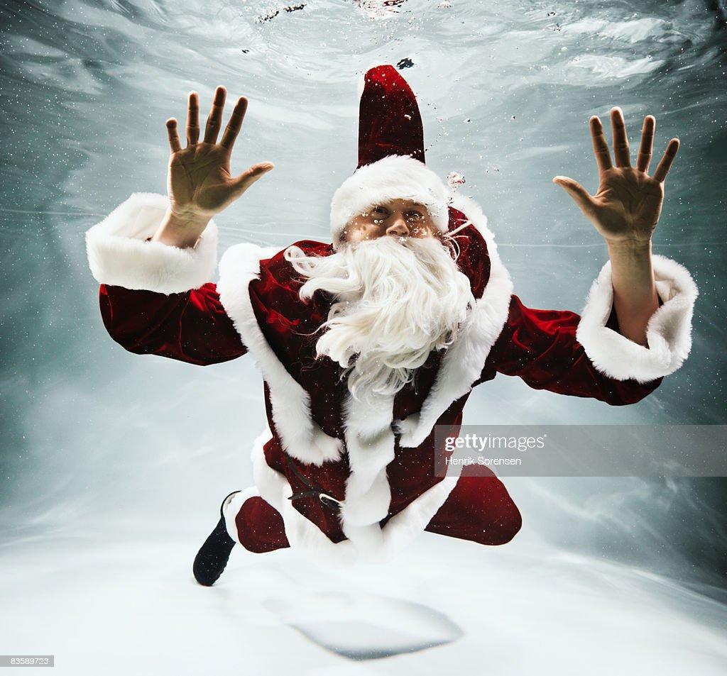 Santa Claus under water : Stock Photo