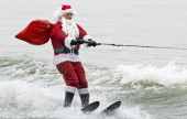 Santa Claus waterskis on Potomac River near Washington DC December 24 at National Harbor in Maryland during th 27th Annual Water Skiing show This...