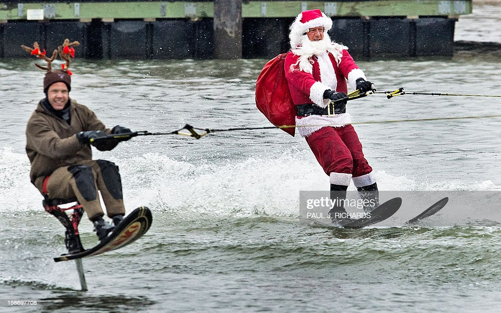 Santa Claus water-skis on Potomac River with a 'reindeer' December 24, 2012 at National Harbor in Maryland,near Washington, DC, during th 27th Annual Water Skiing show. This unusual annual event features a water-skiing Santa, flying elves, the Jet-skiing Grinch, and Frosty the Snowman performing on the Potomac River. AFP PHOTO/Paul J. Richards