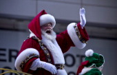 Santa Claus waves during the Macy's Thanksgiving Day Parade on November 28 2013 in New York City Despite earlier concerns about the wind the balloons...