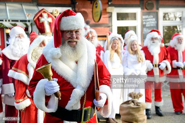 Santa Claus Willi Dahmen holds a bell during a Santa Claus training in Celle northern Germany on October 31 2015 Participants learn how to behave and...