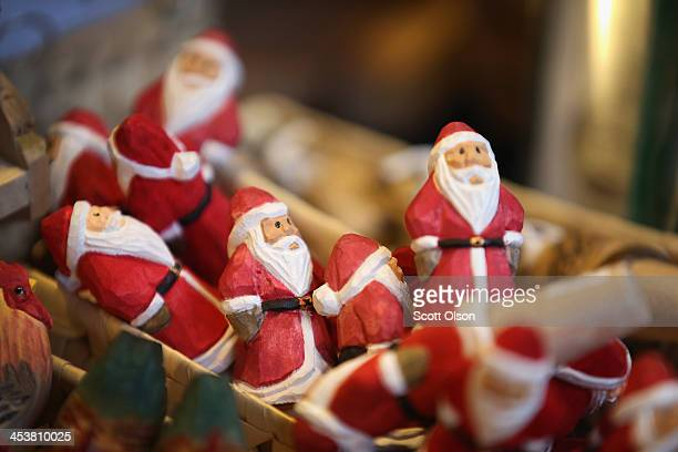 Santa Claus wine stoppers are offered for sale at Christkindlmarket Chicago on December 4 2013 in Chicago Illinois Christkindlmarket Chicago is a...