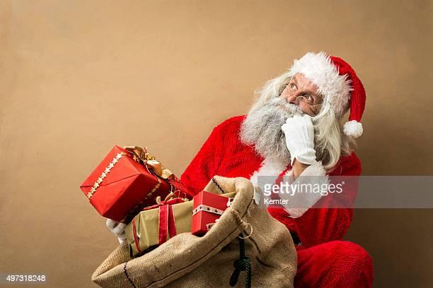 サンタクロース、多くの彼のギフトバッグ