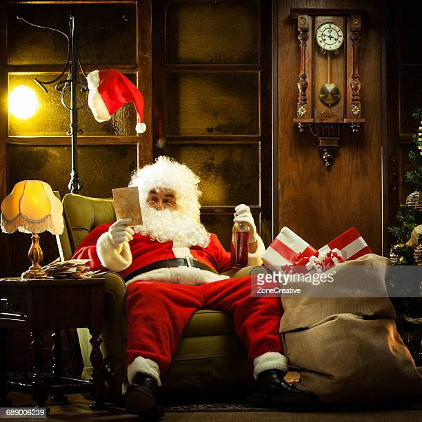 Santa Claus with rum reading children's letters
