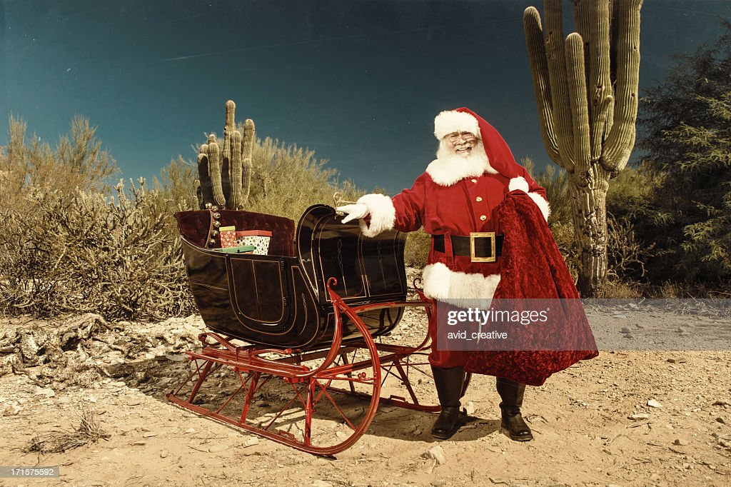 Santa Claus with sleigh in desert