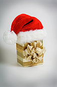 Santa Clause hat on top of gift