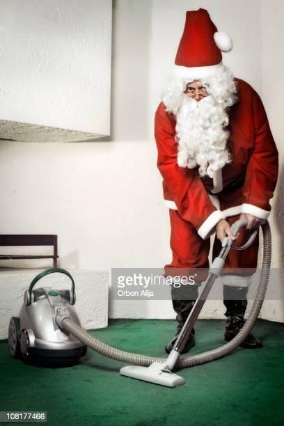Santa Clause Vacuuming Carpet