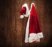 Santa costume hanging on a wooden wall shot with a tilt and a shift lens