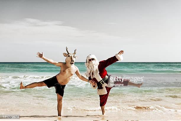 Santa dancing with reindeer