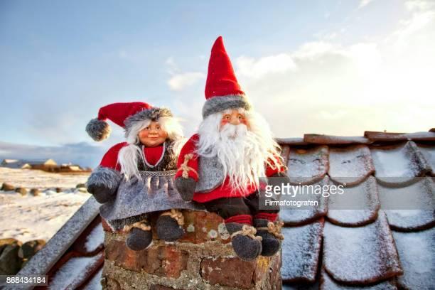 Santa doll sitting on the chimney