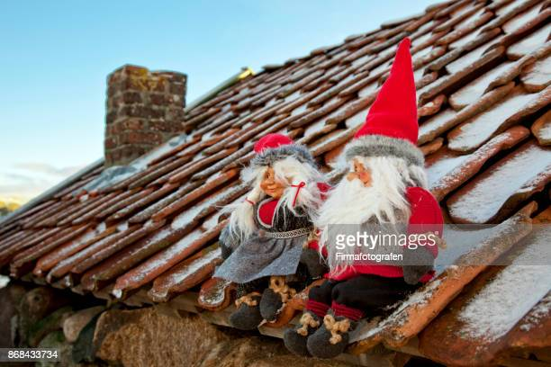 Santa doll sitting on the roof