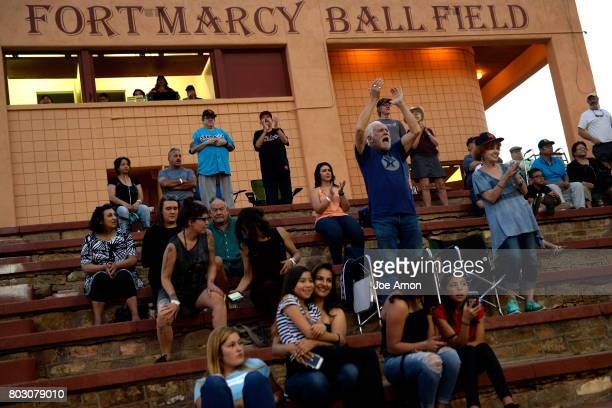 Santa Fe Fuego fan Bo Brumble and his wife Maggie cheering as their team tries to mount a comeback against the Trinidad Triggers at Old Fort Marcy...