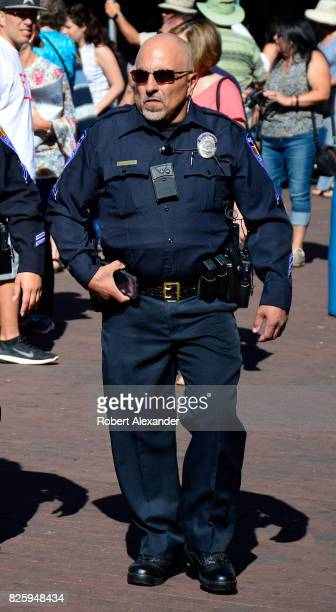 Santa Fe New Mexico police officer walks through the historic Plaza in Santa Fe New Mexico during a festival in the capital city