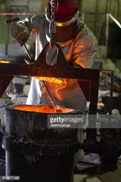 Santa Fe, NM: Worker Checking Temperature of Bronze, Shidoni Foundry