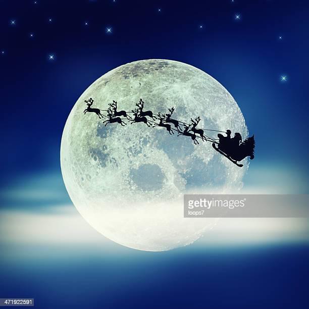 Santa volant au-dessus de la Lune