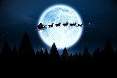 Digitally generated Santa flying over night sky