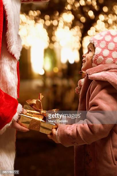 Santa giving gift to little girl
