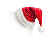Santa hat hanging on white board