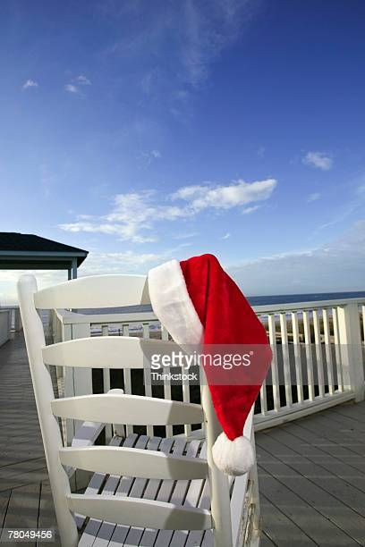 Santa hat on rocking chair outdoors
