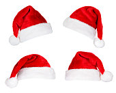 Four Santa Hats isolated on white.