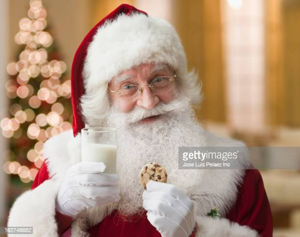 Santa having milk and cookies