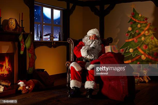 Santa holding a bag full ofchristmas gifts