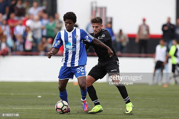 Santa Iria midfielder Dolgon vies with Guimaraes' forward Joao Vigario during the Portuguese Cup match between Santa Iria and Guimaraes at Campo do...