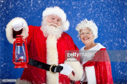 Santa Lighting The Way For Mrs Claus Stock Photo