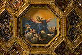 Domenichino's octagonal ceiling painting, Assumption of the Virgin (1617) fits in the coffered ceiling, Church of Santa Maria in Trastevere. Rome, Italy.http://www.massimomerlini.it/is/rome.jpghttp: