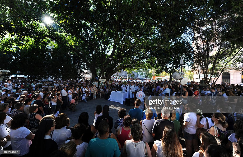 Santa Maria residents attend a multi-religion mass in tribute to the fire victims, at the Saldanha Marinho square on January 28, 2013, in Santa Maria, southern Brazil, where a blaze on the eve at a nightclub killed more than 230 people. Brazilian police arrested four suspects --two of the Kiss club's owners, along with a pair of musicians who starred in the ill-fated pyrotechnic show, in the wake of the nightclub fire that forced sports officials to defend preparations for the World Cup and Olympics.