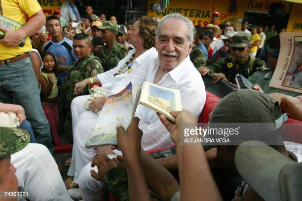 Colombian Nobel Prize for Literature 1982 Gabriel Garcia Marquez sitting alongside his wife Mercedes Barcha is asked by admirers to dedicate them...